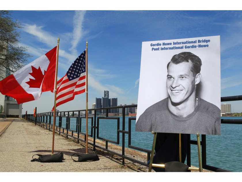 a-photograph-of-gordie-howe-is-displayed-on-the-riverfront-a1